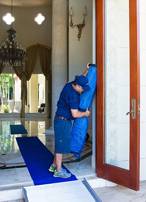 Mover Applying Door-Jamb Protection