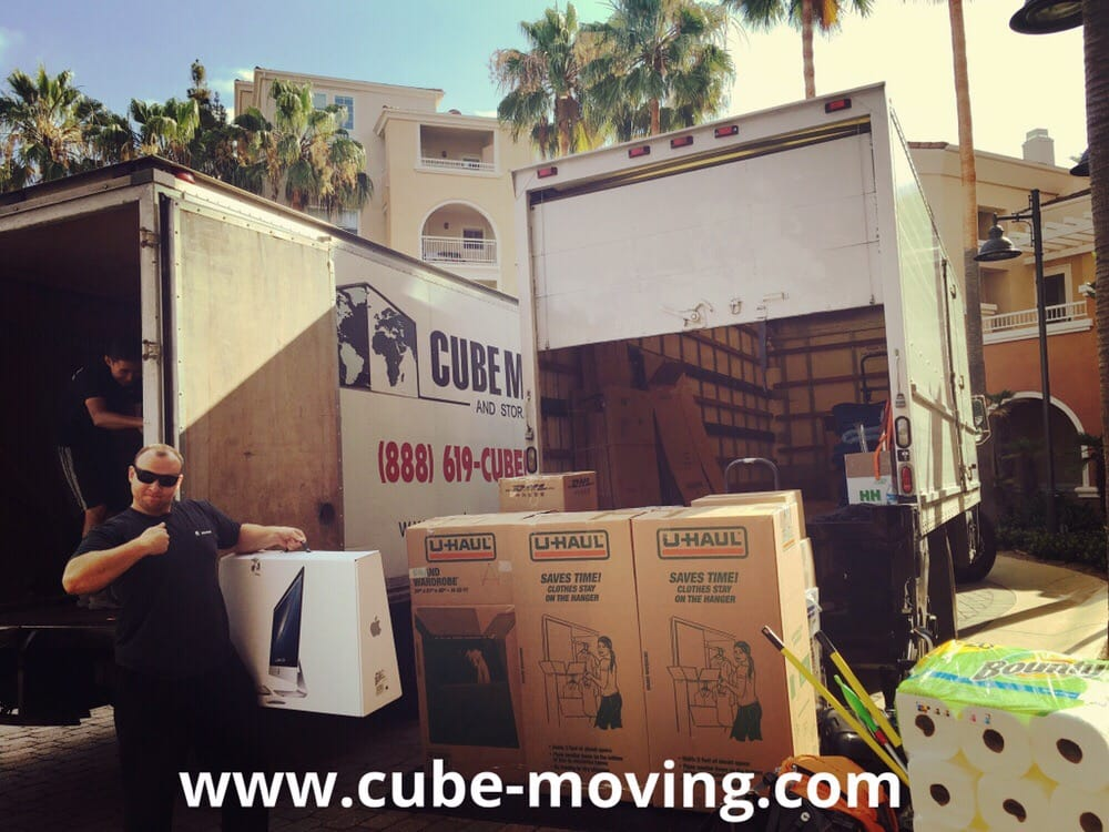 cube movers loading two 26 ft trucks